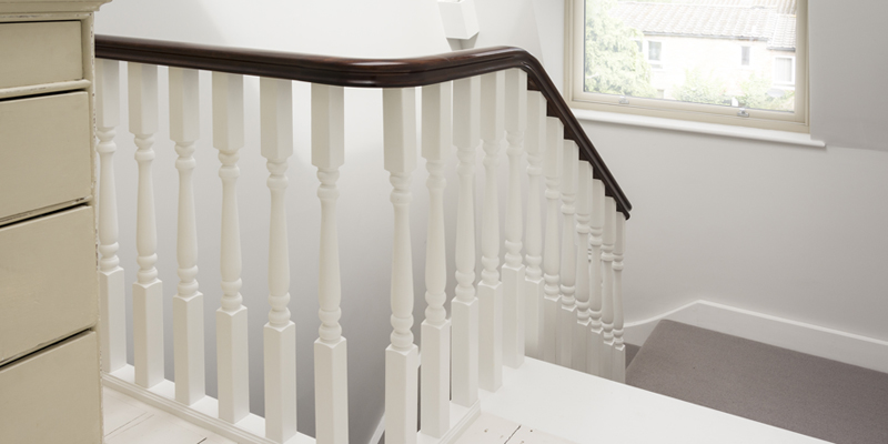 All wood bespoke staircase with painted ballusters and stained handrail